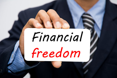 Businessman hand holding Financial freedom concept Stock Photo