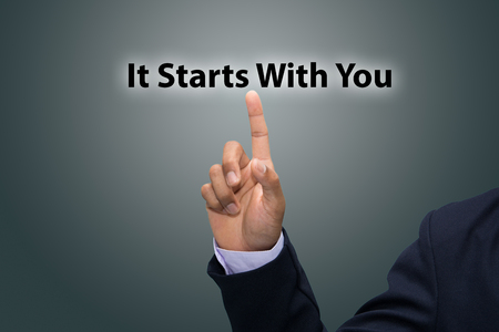 Businessman hand pointing It Starts With You