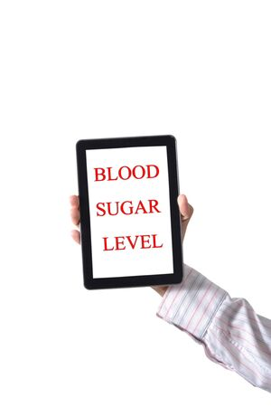 Handle the tablet BLOOD SUGAR LEVEL photo