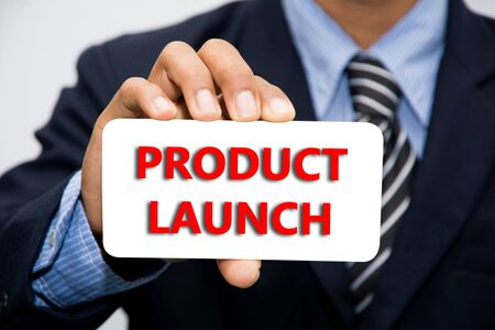 Businessman hand holding PRODUCT LAUNCH concept