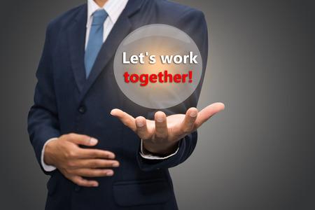 lets: Business man Hand Showing Lets work together!