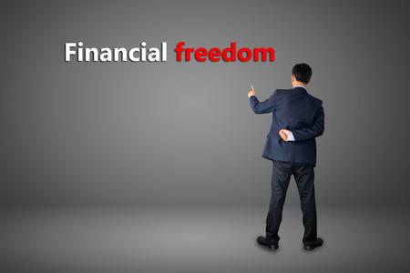 business hand writing Financial freedom photo