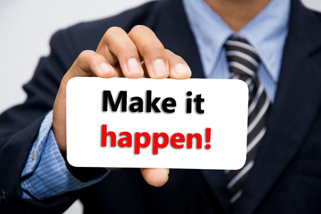 Businessman hand holding Make it happen! concept Stock Photo