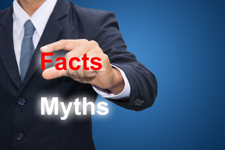 Business man Hand Showing Facts instead of Myths. photo