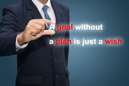 Businessman hand holding A goal without a plan is just a wish