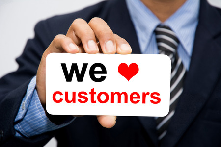 excellent customer service: Businessman hand holding we love customers concept