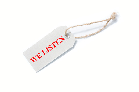 writing a WE LISTEN concept. Stock Photo