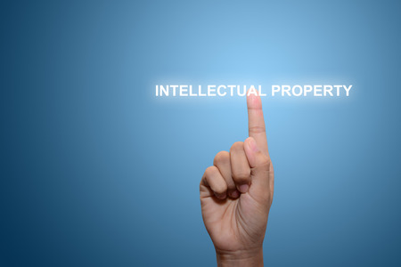 Business man pointing INTELLECTUAL PROPERTY