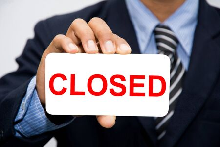 closing time: Businessman hand holding closed concept