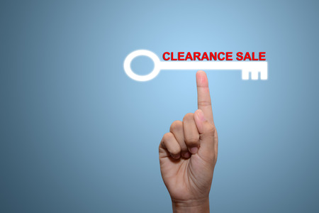 clearance: Business man pointing CLEARANCE SALE Stock Photo