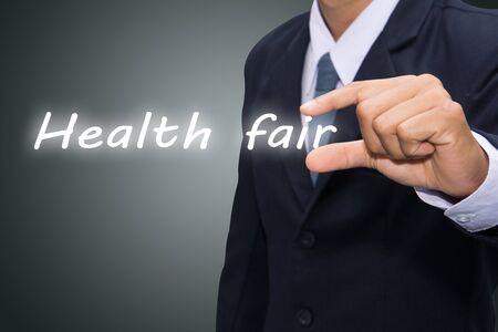 businessman hand write a Health fair