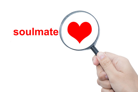 romantic sex: Hand Showing soulmate Word Through Magnifying Glass
