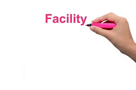 the facility: Business man hand writing  Facility