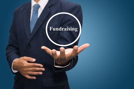 business man hand writing Fundraising Stock Photo