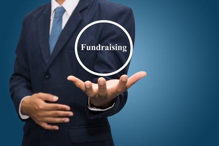 fundraising: business man hand writing Fundraising Stock Photo
