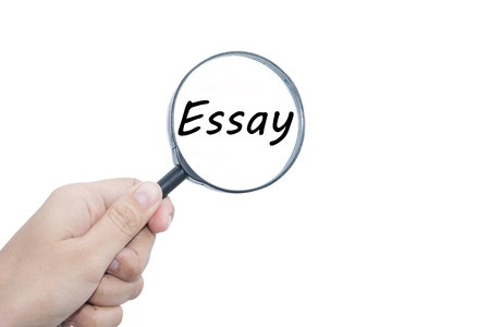 essay: Hand Showing Essay Word Through Magnifying Glass