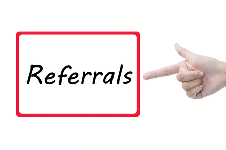 referidos: Businessman hand pointing Referrals Foto de archivo