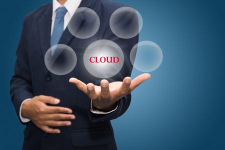 dynamic html: businessman hand write a cloud