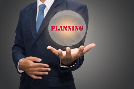 dynamic html: businessman hand write a planning