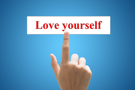 egoistic: writing Love yourself text concept. Stock Photo