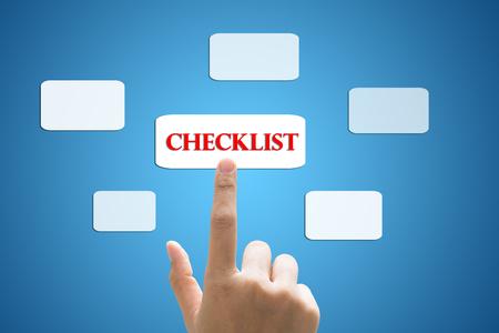 businessman hand write a checklist Standard-Bild