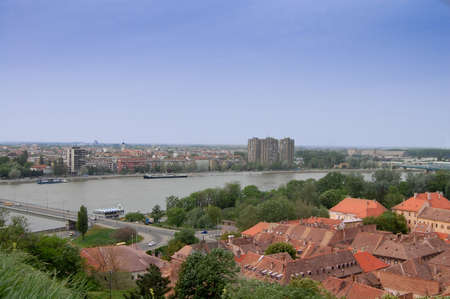 The view over the rooftops of the old town of Petrovaradin, as well as the Danube and the city of Novi Sad. Photographed May o2, 2013. photo