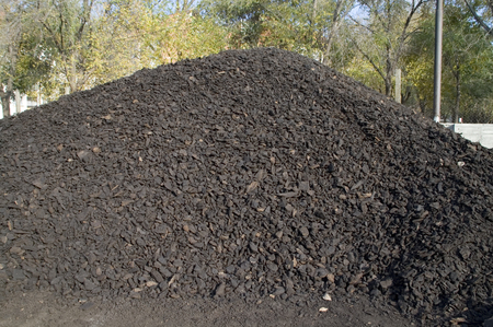 coal mining: Coal washed and dried in a pile in the warehouse waiting for sale.