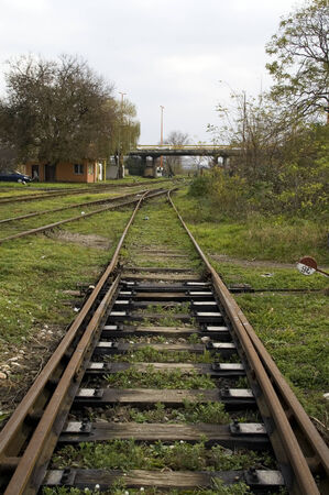 cross ties: Crossover to the railway line is the plant that is used to switch trains from track to track. Stock Photo