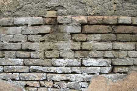 dilapidated wall: The old dilapidated wall of the house that is dilapidated.
