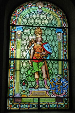 represents: A large stained-glass window that represents the force of progress. Stock Photo
