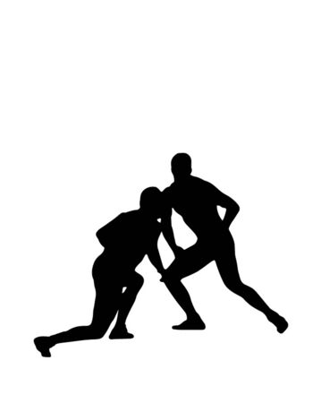 fair play: Silhouette of two wrestlers in the fight on the mat.