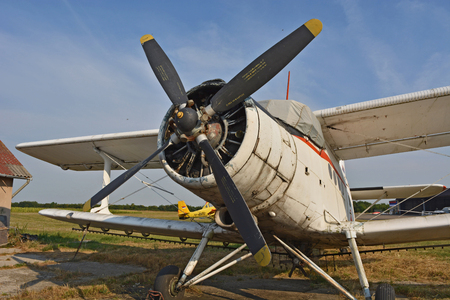 stock photography: Old propeller plane at the airport.