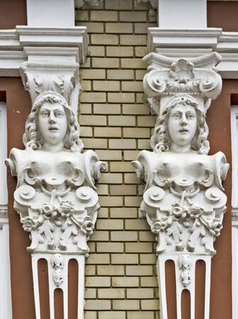 enhances: Ornament placed on the outside of the facade of the house that enhances and protects the house. Stock Photo