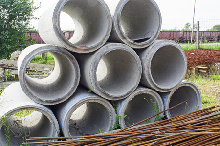 stock photography: The round concrete pipes at the depot waiting for customers.