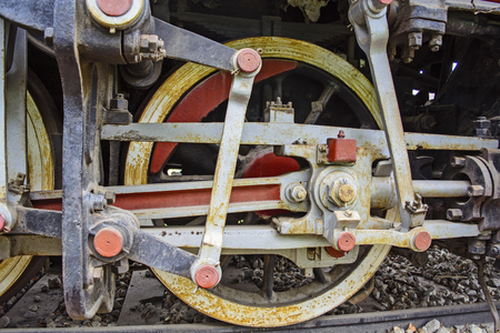 stock photography: Great powerful drive wheel with the mechanism that moves the old steam locomotive.