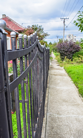 stock photography: Beautiful and functional fences with metal balls at the top of columns.