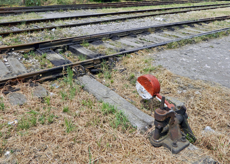 handled: The old device is being handled for rail crossover.
