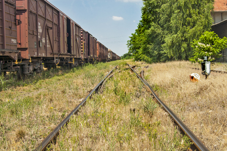 stock photography: The old railway line, and installation lost in the grass.