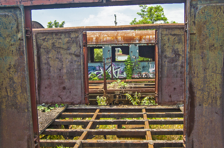 stock photography: Old railway wagon on siding and waiting to cassation or repair.
