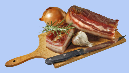 stock photography: Bacon with garlic and knife on wood cutting. Stock Photo