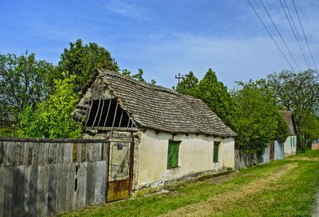 farmhouse: Old dilapidated farmhouse awaiting demolition or repair.