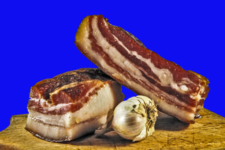 stock photography: Domestic bacon and garlic on wooden kitchen board.