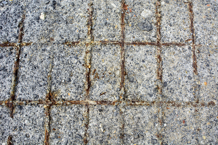 corrosion: Old damaged concrete slab which shows the armature.