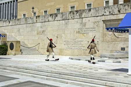 syntagma: ATHENS, GREECE - JUNE 04: 2016. Evzones (presidential guards) watches over the monument of the Unknown Soldier in front of the Greek Parliament Building at Syntagma Square on June 04, 2016 in Athens, Greece.