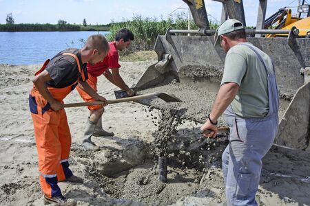 cod hole: Zrenjanin,Serbia - July 20, 2016: Construction work and the workers on the construction of sports fields on the main beach  Pescara  in Zrenjanin. Editorial