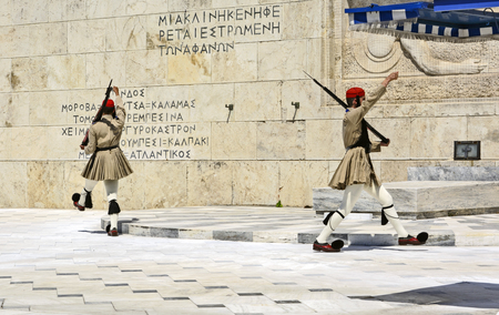 ATHENS, GREECE - JUNE 04: 2016. Evzones (presidential guards) watches over the monument of the Unknown Soldier in front of the Greek Parliament Building at Syntagma Square on June 04, 2016 in Athens, Greece.