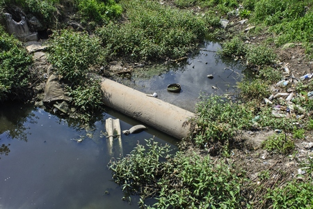 impure: Very polluted river that runs through the village.