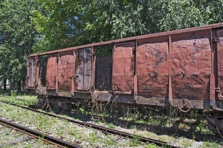 royalty free: Old railway wagon on siding and waiting to cassation or repair.