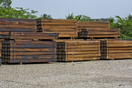 Larger piles of stacked new wooden railway sleepers. Thresholds are waiting for the installation and replacement of old thresholds.