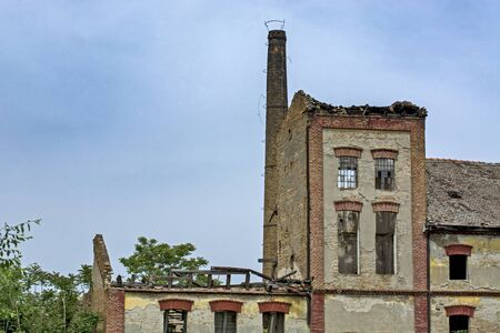 An old abandoned factory that is completely ruined.